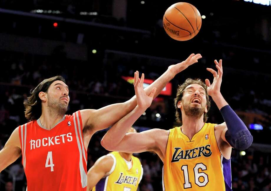 Houston Rockets forward Luis Scola (4), of Argentina, and Los Angeles Lakers forward Pau Gasol (16), of Spain, fight for a loose ball in the first half of an NBA basketball game, Friday, April 6, 2012, in Los Angeles. (AP Photo/Gus Ruelas) Photo: Gus Ruelas, Associated Press / FR157633 AP
