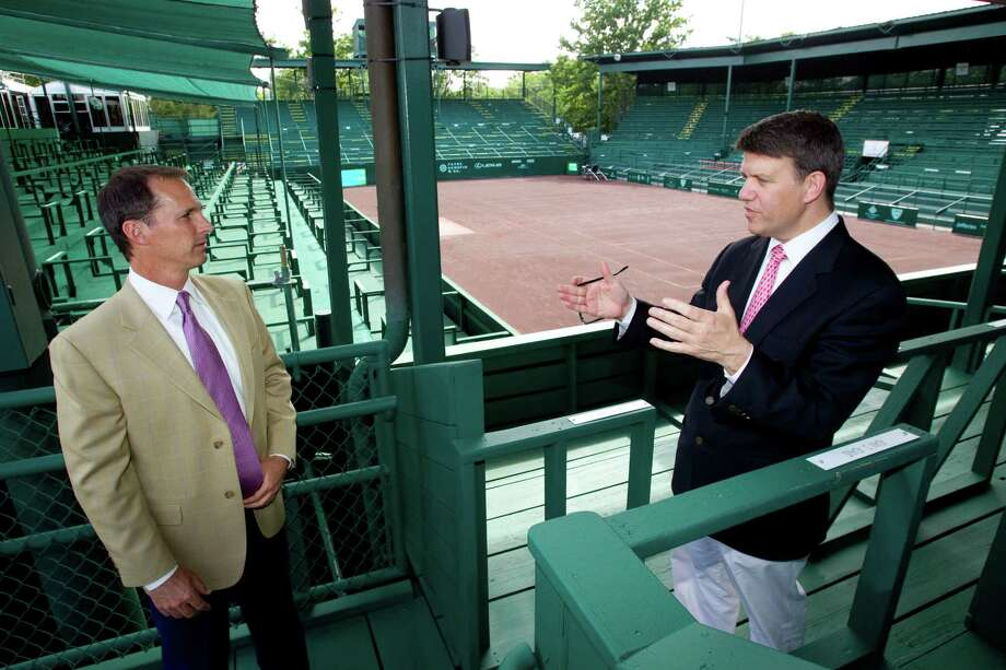 Van Barry, left, tournament director, and David Modesett, tournament chairman, discuss preparations for the U.S. Men's Clay Court Championship at River Oaks. Photo: Brett Coomer / © 2012 Houston Chronicle