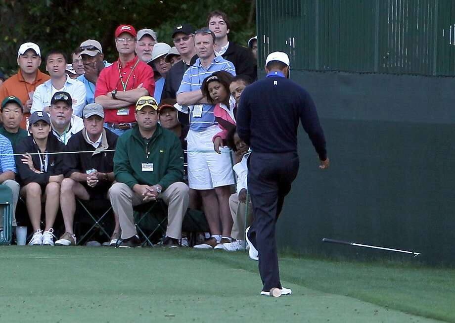 AUGUSTA, GA - APRIL 06:  Tiger Woods of the United States kicks his club after a tee shot on 16th hole during the second round of the 2012 Masters Tournament at Augusta National Golf Club on April 6, 2012 in Augusta, Georgia.  (Photo by Jamie Squire/Getty Images) Photo: Jamie Squire, Getty Images