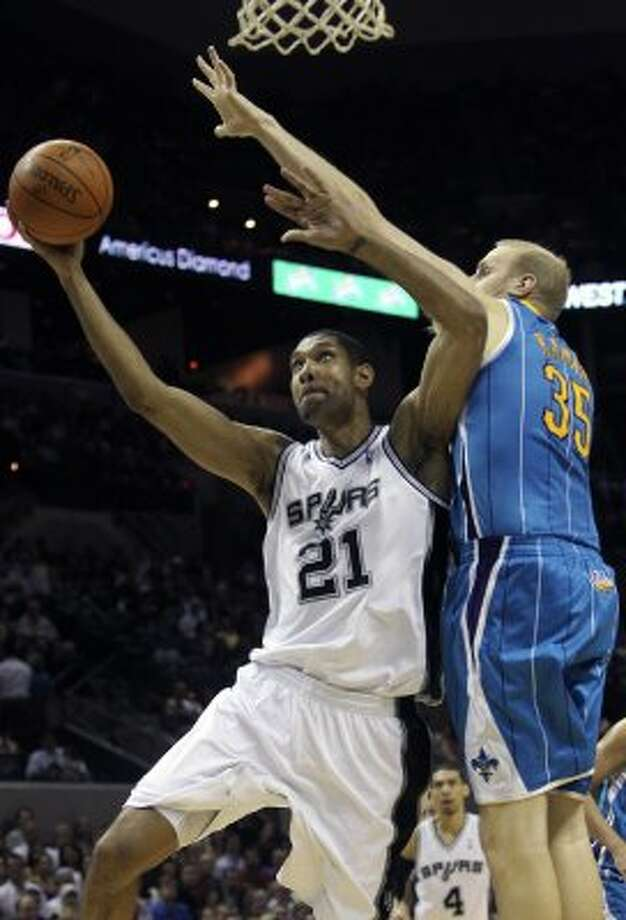 Tim Duncan takes it to the hoop against Chris Kaman as the Spurs play the New Orleans Hornets at the AT&T Center on April 6, 2012.  Tom Reel/ San Antonio Express-News (TOM REEL / San Antonio Express-News)