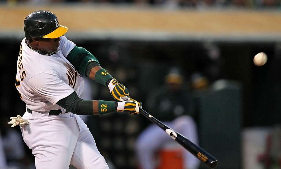Oakland Athletics Yoenis Cespedes hit a deep fly ball to center in the second inning against the Seattle Mariners Friday, April 6, 2012 in Oakland Calif. Photo: Lance Iversen, The Chronicle