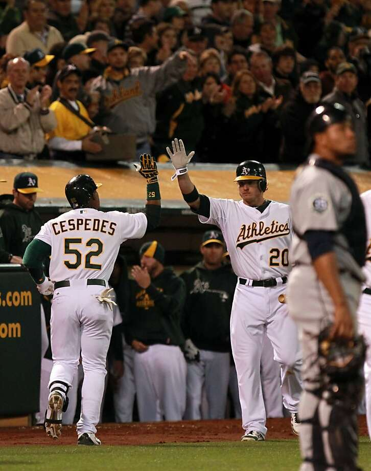 Oakland Athletics Yoenis Cespedes left is greeted by Josh Donaldson after hitting a two run homer in the 4th inning against the Seattle Mariners Friday, April 6, 2012 in Oakland Calif. Photo: Lance Iversen, The Chronicle