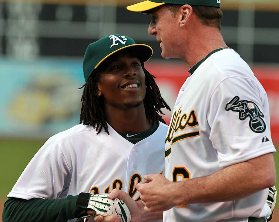 Oakland Athletics Jemile Weeks greets his manager Bob Melvin prior to the start of their home opener with the Seattle Mariners Friday, April 6, 2012 in Oakland Calif. Photo: Lance Iversen, The Chronicle