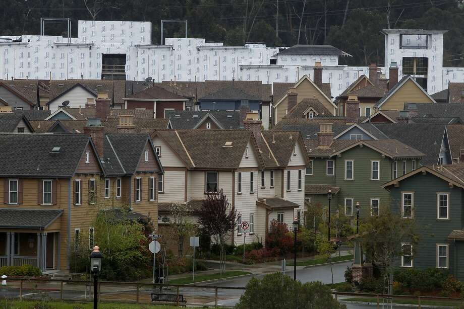 The abandoned Sycamore North development is seen behind a neighborhood in Hercules, Calif. on Tuesday, March 27, 2012. Residents of the cash-strapped city will vote on an emergency sales tax increase measure in the June election. Photo: Paul Chinn, The Chronicle