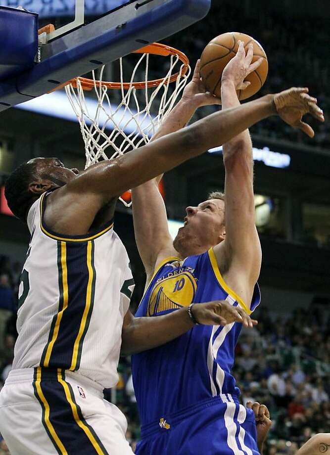 Golden State Warriors power forward David Lee (10) goes up to score against Utah Jazz center Al Jefferson (25) during the first half of an NBA basketball game, Friday, April 6, 2012, in Salt Lake City.  (AP Photo/Colin E Braley) Photo: Colin E. Braley, Associated Press
