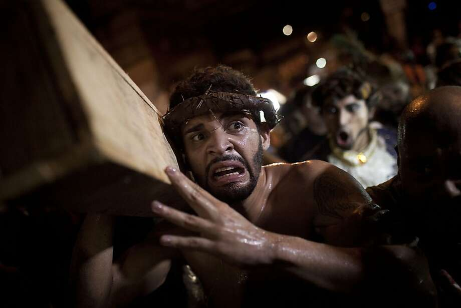 A man participates in a reenactment of the Passion of Jesus Christ on Good Friday during Holy Week celebrations at Rocinha slum in Rio de Janeiro, Brazil, Friday April  6, 2012. Holy Week commemorates the last week of the life of Jesus, culminating in his crucifixion on Good Friday and his resurrection on Easter Sunday.  (AP Photo/Felipe Dana) Photo: Felipe Dana, Associated Press