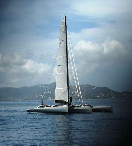 The Nigel Irens 63-foot trimaran Paradox owned by a Redwood City man prepares to race in the British Virgin Islands for the 41st annual BVI Regatta and Sailing Festival. Photo: Paul Oliva
