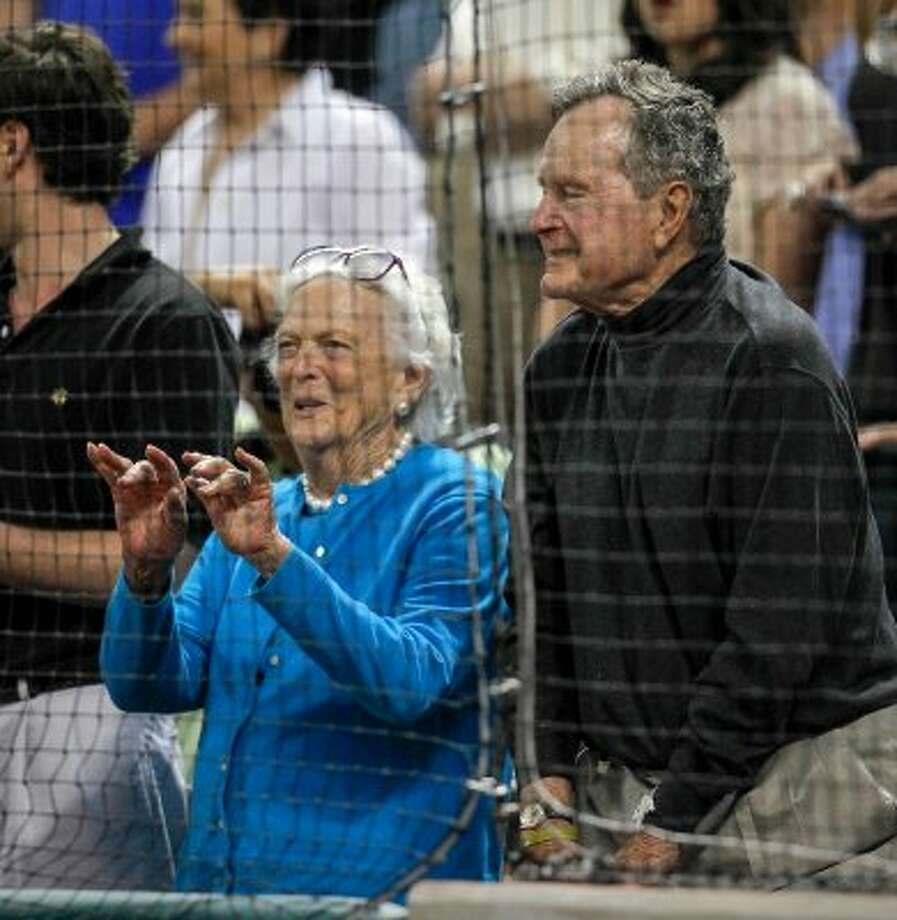 "Former President George H.W. Bush looks on as Barbara Bush waves toward Clay Walker as he sings ""Take Me Out to the Ballgame"" during the seventh inning stretch. (Karen Warren / Houston Chronicle)"