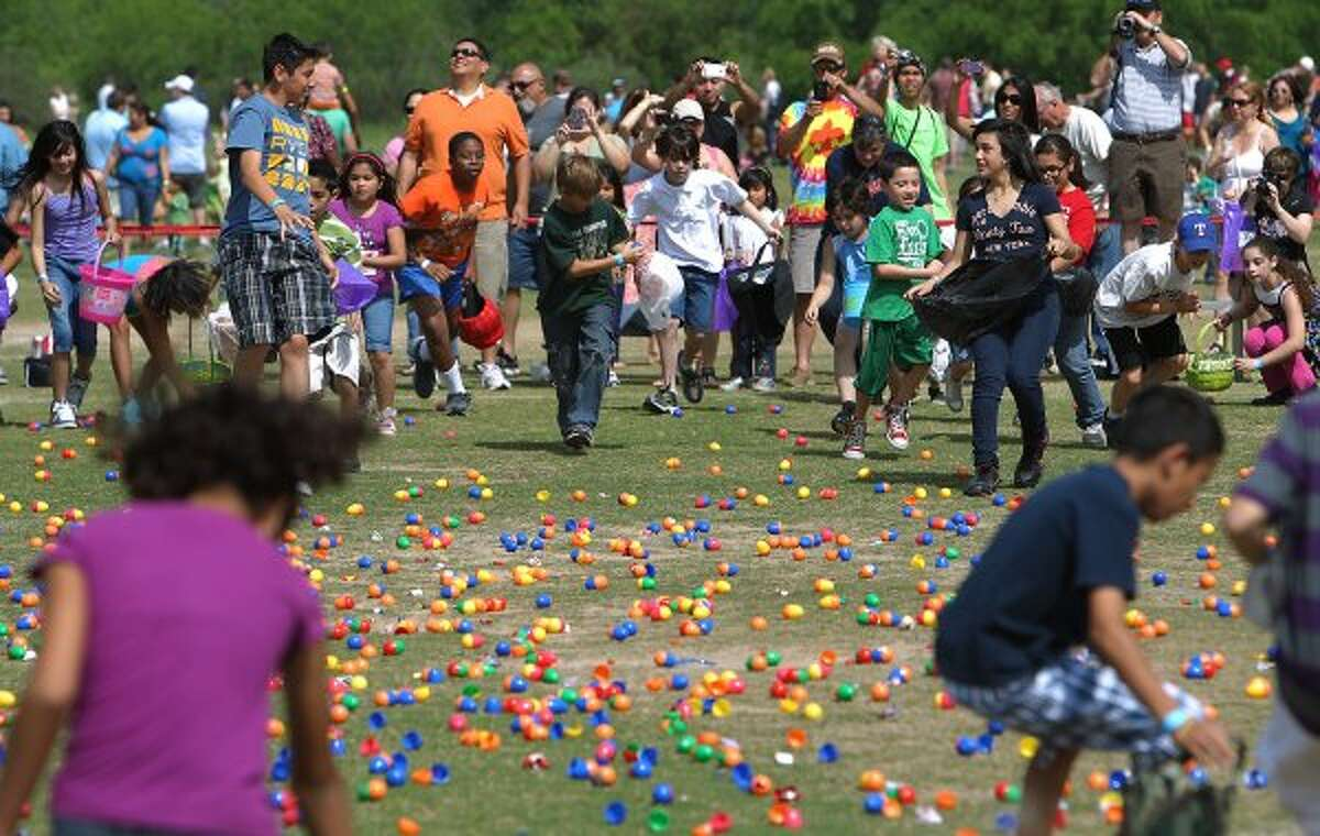Kids make a mad dash for plastic eggs as West U - the west campus of University United Methodist Church - hosts an Easter egg drop at O.P. Schnabel Park for several hundred children up to age 12 on Saturday, Apr. 7, 2012. (Kin Man Hui / San Antonio Express-News)