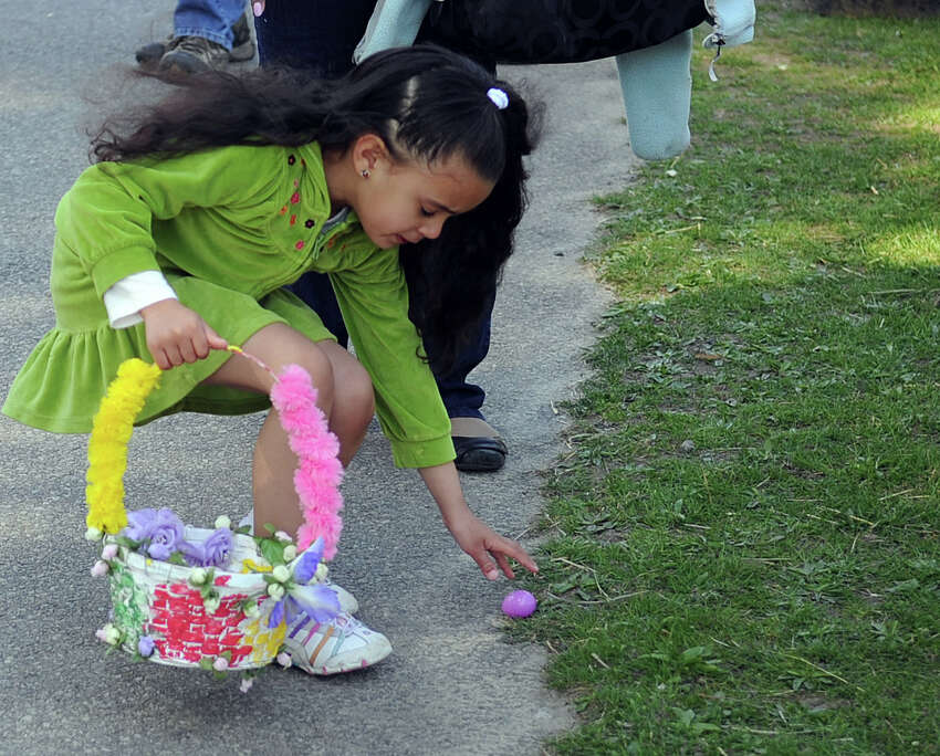Grace Montelli, 6, finds an egg during Saturday's 8th annual Easter Egg Hunt at Heckscher Farm at the Stamford Museum and Nature Center on April 7, 2012.