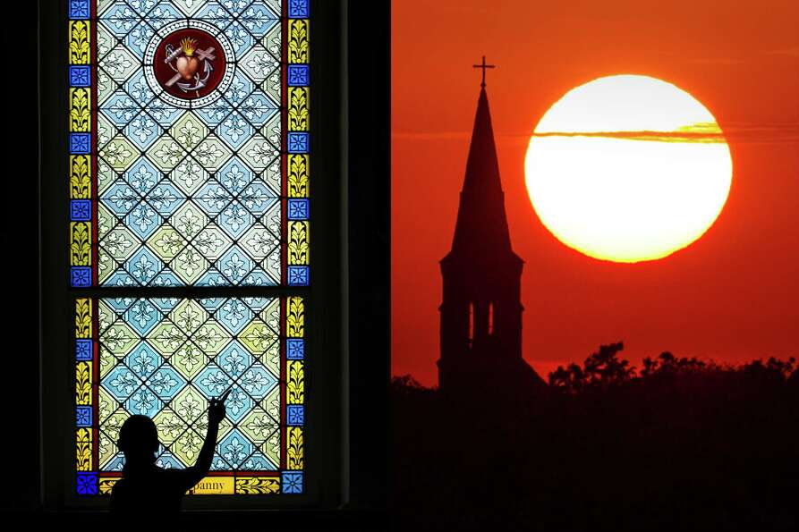 LEFT: Visitors examine stained glass at St. Mary's Church during a tour in Praha. RIGHT: The sun set