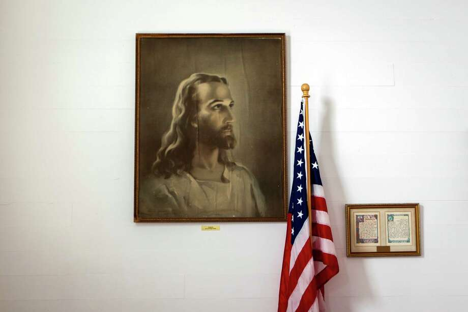 A portrait of Jesus hangs on a wall next to the American flag at Freyburg United Methodist Church. Photo: Smiley N. Pool, Houston Chronicle / © 2012  Houston Chronicle