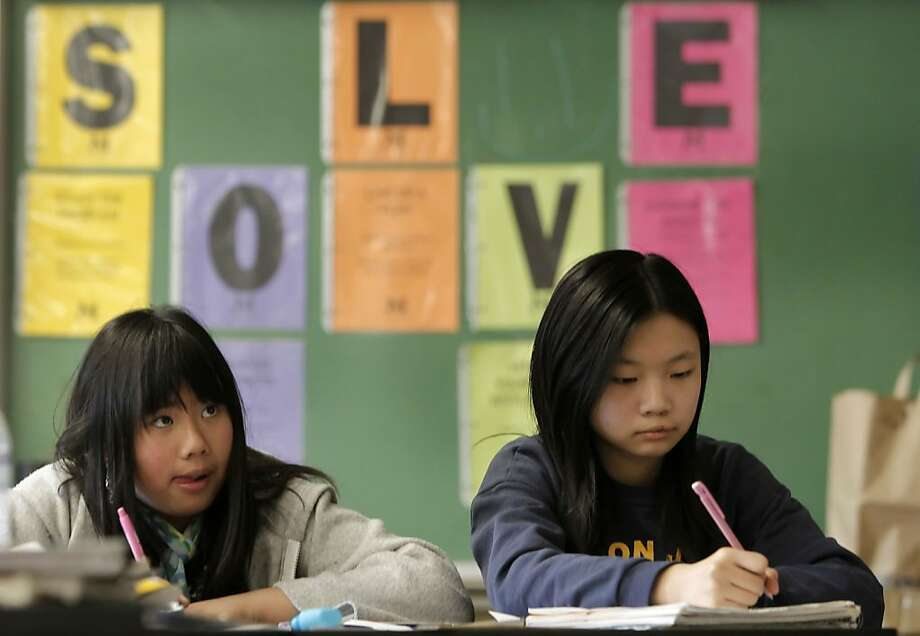 Dianna Trieu, (left) and Tina Ye, work on geometry, during 6th grade math class at Roosevelt Middle School, in San Francisco, Ca., on Thursday April 5, 2012. Stanford researchers have found proof that math anxiety is a real thing, certain people seem prone to feeling real anxiety when it comes to doing math, and that anxiety in turn hampers their ability to do math in the first place. They got their proof from studying second- and third-grade students and performing MRIs on them while they did simple math problems Photo: Michael Macor, The Chronicle