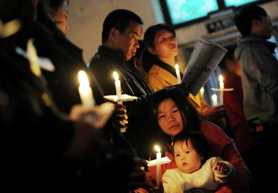 Chinese Catholics pray at an Easter service on Saturday in Beijing. Photo: MARK RALSTON, AFP/Getty Images / AFP