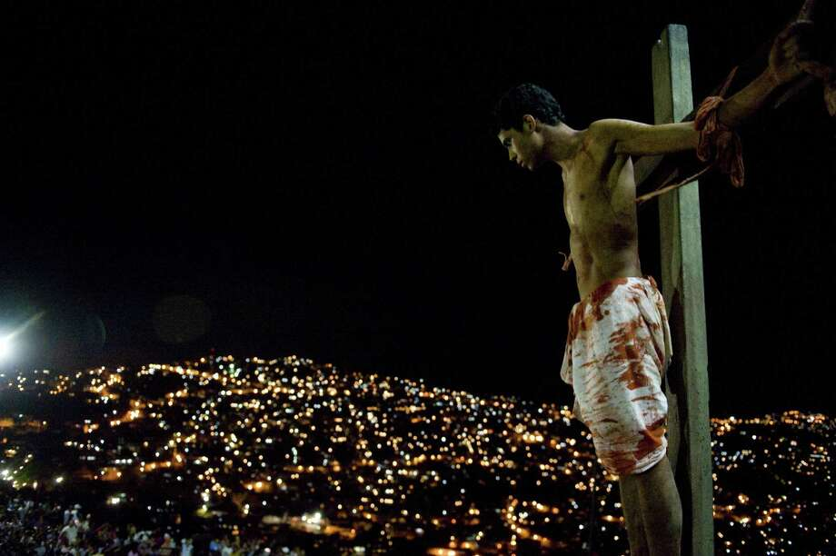 A man depicting Christ takes part in a representation of the passion of Christ during Good Friday at Petare shatytown, in Caracas on April 6, 2012. Photo: LEO RAMIREZ, AFP/Getty Images / AFP