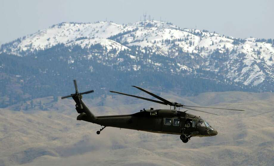 A UH-60 Black Hawk helicopter piloted by a crew from the Idaho Army National Guard Citizen Soldiers of Company A, 1-168 General Support Aviation Battalion lifts off from Gowen Field in Boise, Idaho on Saturday, April 7, 2012 as part of a one-year deployment to Afghanistan. Photo: Charlie Litchfield, Associated Press / Idaho Press-Tribune