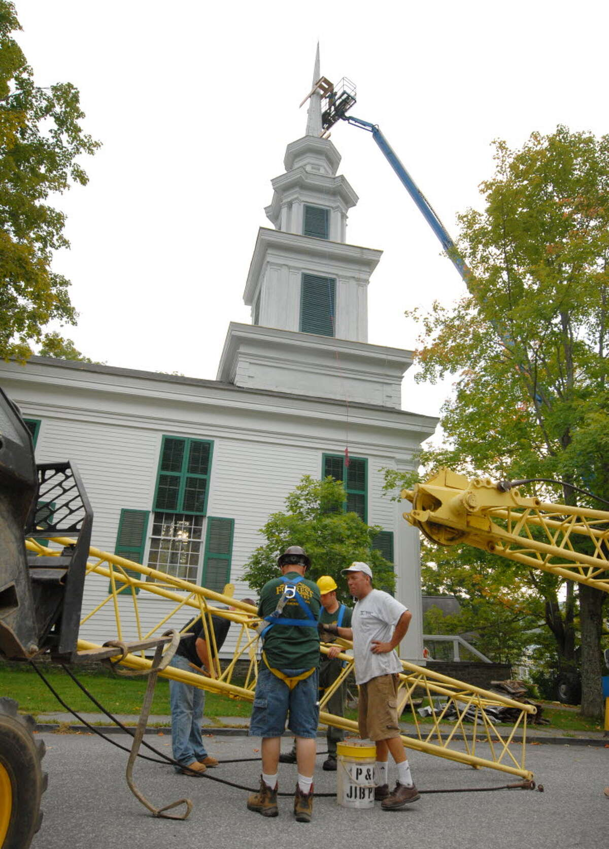 Workers prepare to remove the Rensselaerville Presbyterian Church spire for repairs in Rensselaerville Friday morning in Rensselaerville, September 3, 2010. (Will Waldron / Times Union)