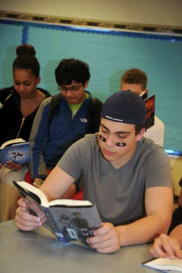 """Jason Del Vecchio, 17, reads in Greenwich High School's Literacy Workshop Wednesday, April 4, 2012. Students read and studied """"The Hunger Games,"""" before watching the movie. Photo: Helen Neafsey / Greenwich Time"""
