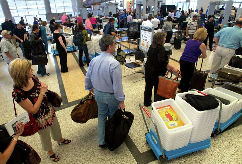 Hobby Airport travelers face a maximum screening wait time of 31 minutes or more, which TSA says is less than in some other major cities. Photo: Cody Duty / © 2011 Houston Chronicle