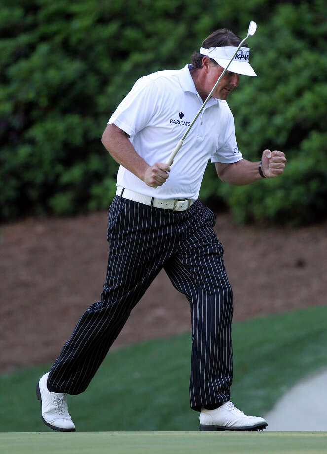 Phil Mickelson pumps his fist sinking a eagle putt on the 13th green during the third round of the Masters golf tournament at Augusta National Golf Club on Saturday, April 7, 2012, in Augusta, Ga (AP Photo/Atlanta Journal-Constitution, Curtis Compton)  MARIETTA DAILY OUT; GWINNETT DAILY POST OUT Photo: Curtis Compton, ASSOCIATED PRESS / AP2012