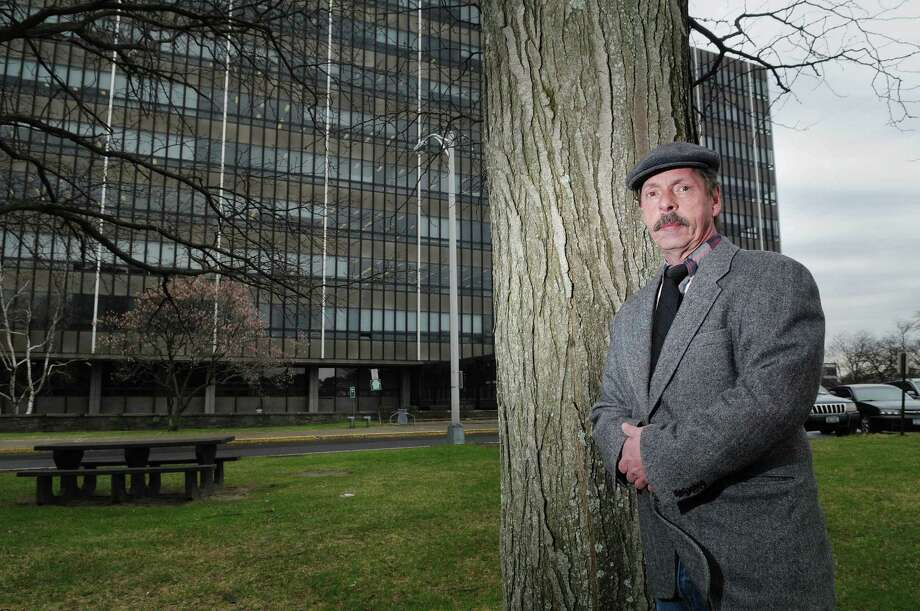 Leo LaMountain, a former Office for Technology employee, poses outside the Tax & Finance building at the Harriman State Office Campus on Wednesday, March 28, 2012 in Albany, NY.  LaMountain worked for a while in the Tax and Finance building where the Office for Technology has some employees.  (Paul Buckowski / Times Union) Photo: Paul Buckowski