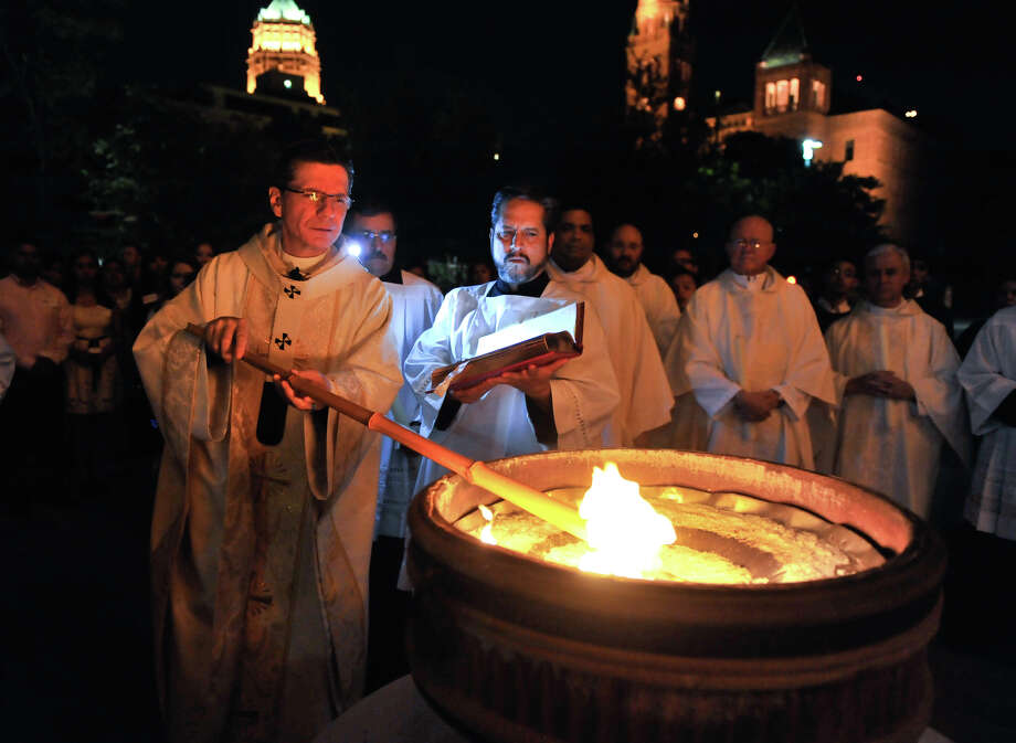 San Antonio Archbishop Gustavo Garcia-Siller lights the Paschal Candle in front of San Fernando Cathedral during the beginnig of the Easter Vigil Ceremony. Photo: Robin Jerstad, Robin Jerstad/For The Express-News / Robin Jerstad