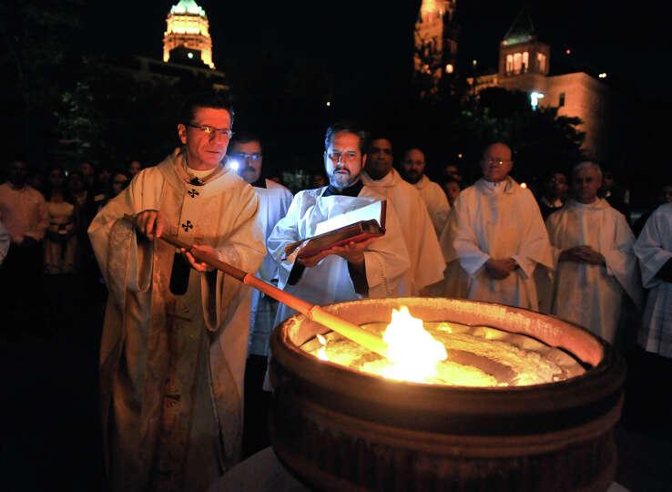 San Antonio Arch Bishop Gustavo Garcia Siller lights the Paschal Candle in front of San Fernando