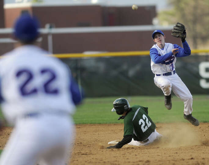 Saratoga's Matt Flynn throws the ball to first base for a double play getting Shenendehowa runner Gr