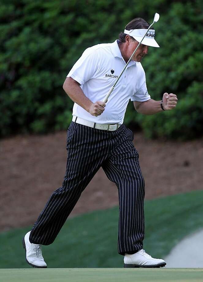 Phil Mickelson pumps his fist sinking a eagle putt on the 13th green during the third round of the Masters golf tournament at Augusta National Golf Club on Saturday, April 7, 2012, in Augusta, Ga (AP Photo/Atlanta Journal-Constitution, Curtis Compton)  MARIETTA DAILY OUT; GWINNETT DAILY POST OUT Photo: Curtis Compton, Associated Press