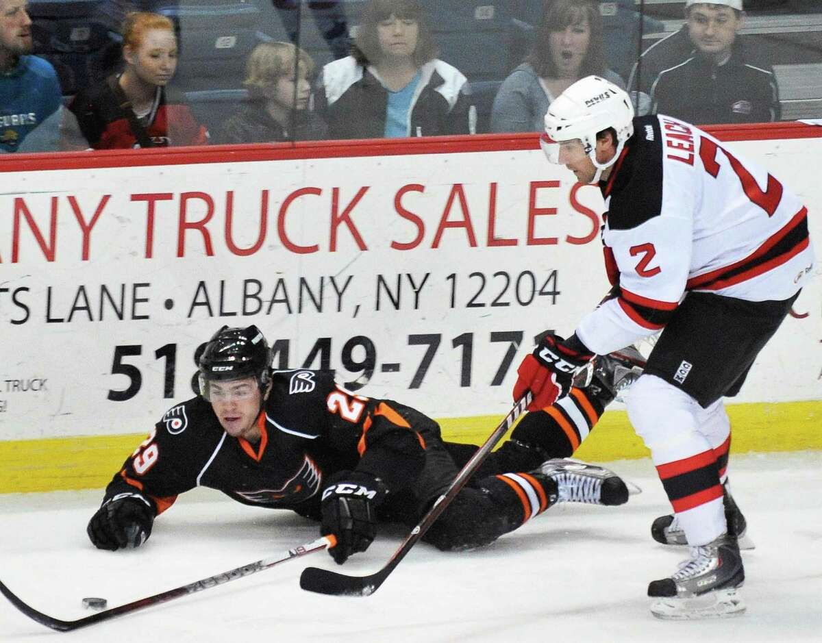 Adirondack's #29 Derek Mathers, left, and Devils's #2 Jay Leach during Saturday night's game at the Times Union Center in Albany April 7, 2012. (John Carl D'Annibale / Times Union)