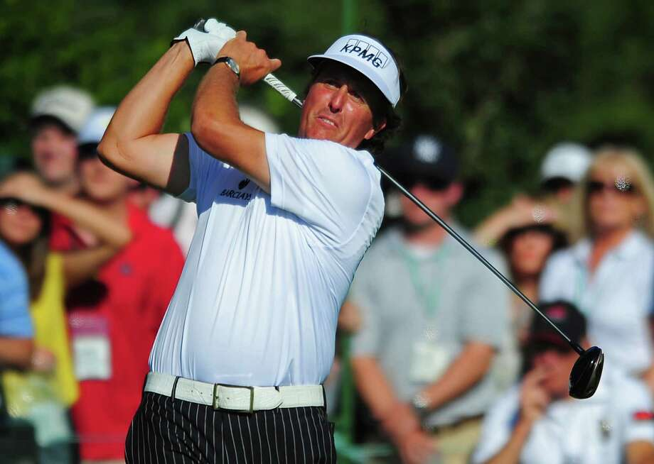 Phil Mickelson watches his drive from the 15th tee during the third round of The Masters at the Augusta National Golf Club in Augusta, Georgia, Saturday, April 7, 2012. (Jeff Siner/Charlotte Observer/MCT) Photo: Jeff Siner, McClatchy-Tribune News Service / Charlotte Observer