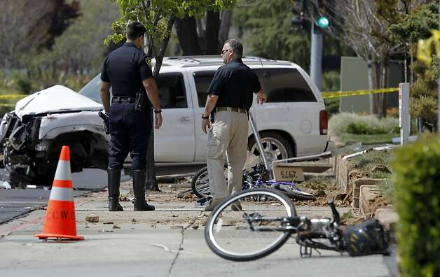 The three bicycles lay on the sidewalk as the investigation of the scene continues after a 17-year-old male driver, who is being charged with manslaughter when the vehicle he was driving hit the 3 bicyclists on Treat Blvd. at Oak Grove in Concord, Ca. killing a father, Soliaman Nuri, and his 9-year-old daughter Hadesa Nuri, and leaving a second daughter, a 12-year-old with minor injuries, on Saturday April 7, 2012. Photo: Michael Macor, The Chronicle
