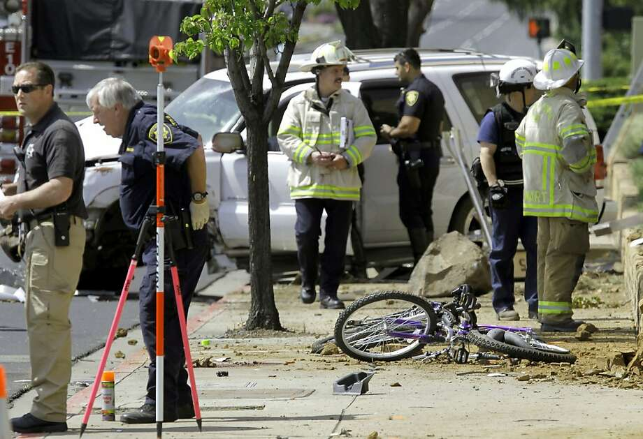 Two of the three bicycles lay on the sidewalk, as the investigation of the scene continues after  a 17-year-old male driver from Concord is being charged with manslaughter when the vehicle he was driving hit 3 bicyclists on Treat Blvd. at Oak Grove in Concord, Ca. killing a father, Soliaman Nuri, and his 9-year-old daughter Hodees Nuri, and leaving a second daughter, a 12-year-old with minor injuries, on Saturday April 7, 2012. Photo: Michael Macor, The Chronicle
