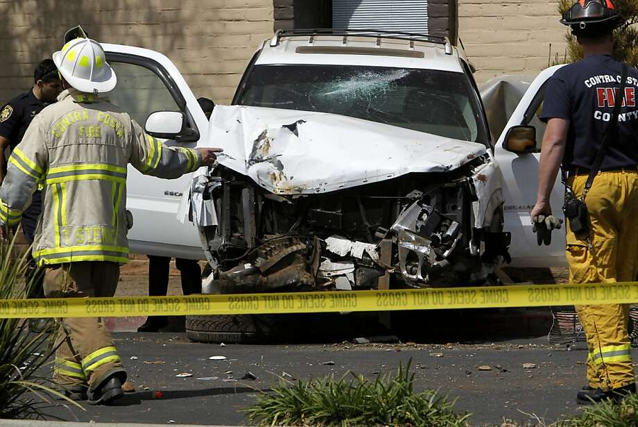A wrecked SUV sits on the sidewalk at the scene of a fatal crash on Treat Blvd. at Oak Grove in Concord on Saturday April 7, 2012. Photo: Michael Macor, The Chronicle