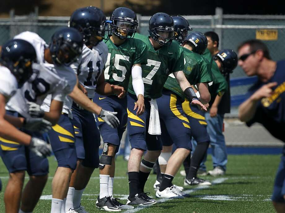 Quarterbacks Zach Maynard (15) and Austin Hinder (7) stretch with Cal Bears teammates during a spring football practice in Berkeley, Calif. on Saturday, April 7, 2012. Photo: Paul Chinn, The Chronicle
