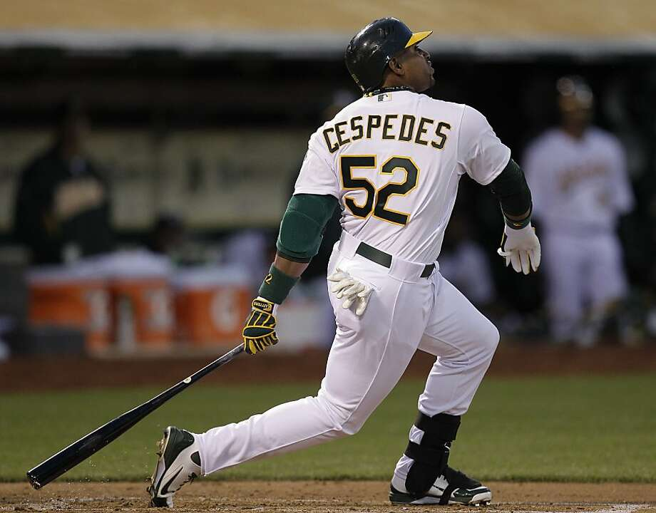 Oakland AThletics' Yoenis Cespedes flies out on a pitch from Seattle Mariners' Jason Vargas during the second inning of a baseball game Friday, April 6, 2012, in Oakland, Calif. (AP Photo/Ben Margot) Photo: Ben Margot, Associated Press