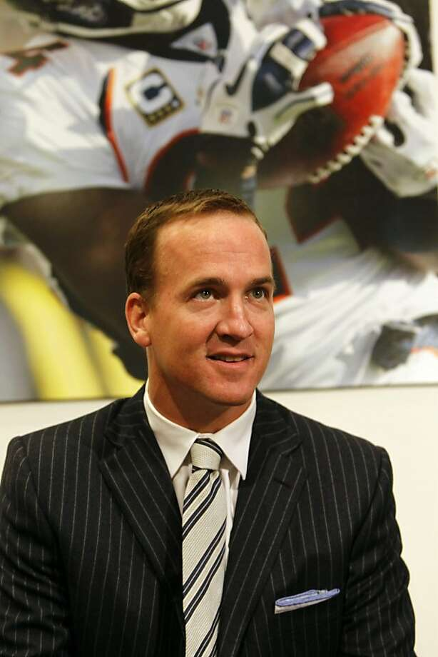 Denver Broncos quarterback Peyton Manning looks on during a news conference at the team's headquarters in Englewood, Colo., on Tuesday, March 20, 2012. (AP Photo/David Zalubowski) Photo: David Zalubowski, Associated Press
