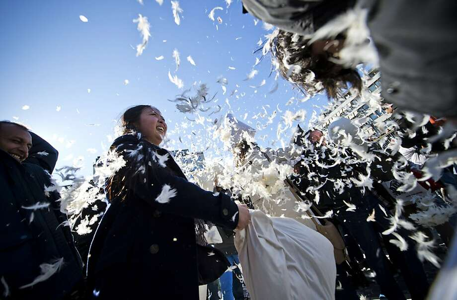TOPSHOTS People attend a flash-mob pillow fight during International Pillow Fight Day on April 7, 2012 in Stockholm. Many cities around the world are due to participate in the fifth annual edition. AFP PHOTO/JONATHAN NACKSTRAND (Photo credit should read JONATHAN NACKSTRAND/AFP/Getty Images) Photo: Jonathan Nackstrand, AFP/Getty Images
