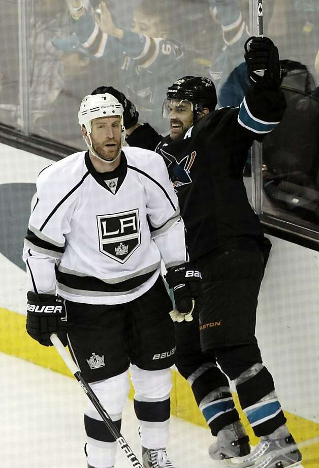 San Jose Sharks defenseman Dan Boyle (22) celebrates his game-winning goal in overtime next to Los Angeles Kings defenseman Rob Scuderi (7) during an NHL hockey game Saturday, April 7, 2012 in San Jose, Calif. San Jose won 3-2. (AP Photo/Marcio Jose Sanchez) Photo: Marcio Jose Sanchez, Associated Press