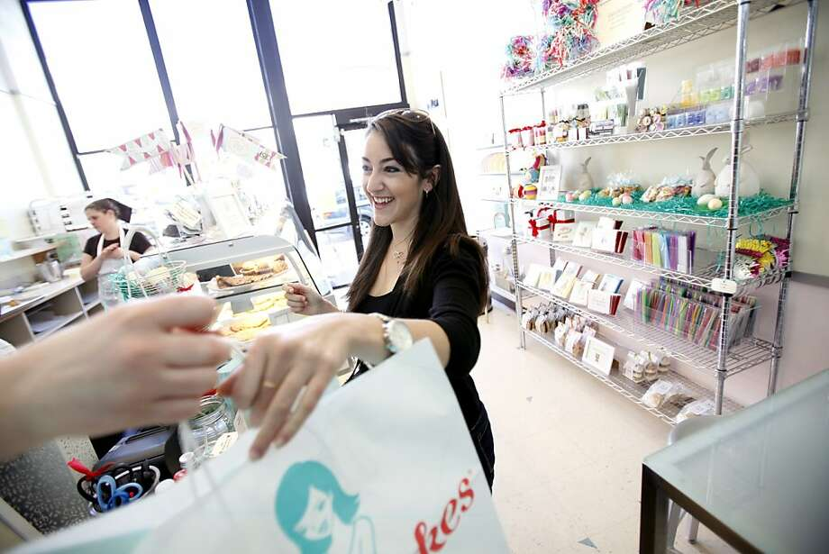 "TaskRabbit Maya Wolpert picks up cupcakes from SusieCakes to deliver for a birthday surprise in San Francisco, Calif., Friday, April 6, 2012.  TaskRabbit is part of a burgeoning sharing economy that is springing up outside normal business boundaries.  The company hooks workers up with people who need errands done.  ""I love running errands,"" Wolpert said, so she jumped at the opportunity to get paid for the task. Photo: Sarah Rice, Special To The Chronicle"