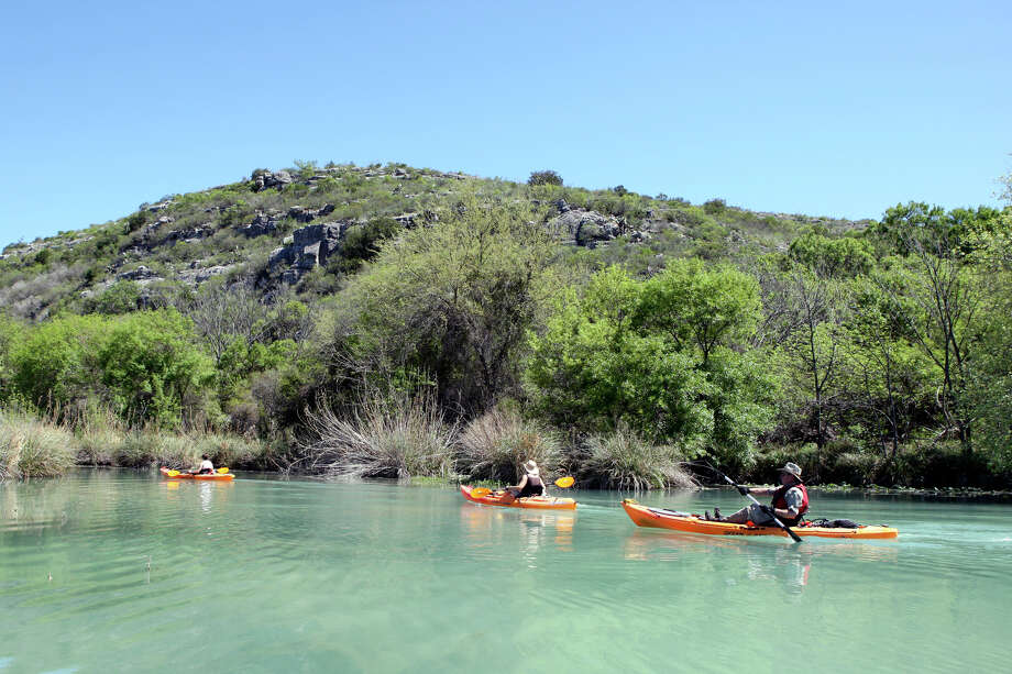Texas Parks and Wildlife Natural Resource Specialist Kristi Drakeon, (from left), Tammy Watson, and her husband Texas State Park Police Lt. Ken Watson paddle the Devils River. Photo: EDWARD A. ORNELAS, SAN ANTONIO EXPRESS-NEWS / © SAN ANTONIO EXPRESS-NEWS (NFS)
