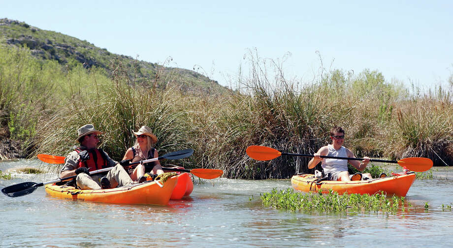Texas State Park Police Lt. Ken Watson (from left) his wife Tammy Watson, and Texas Parks and Wildlife Natural Resource Specialist Kristi Drake paddle the Devils River. Photo: EDWARD A. ORNELAS, SAN ANTONIO EXPRESS-NEWS / © SAN ANTONIO EXPRESS-NEWS (NFS)