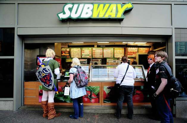 A man dressed as Link from the Legend of Zelda grabs some Subway. Photo: LINDSEY WASSON / SEATTLEPI.COM