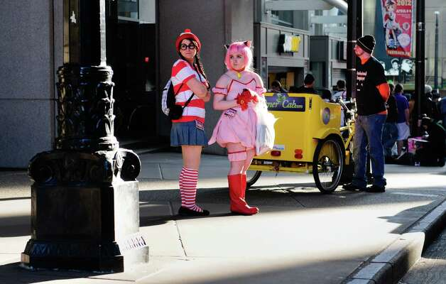 Ellen Beckman, dressed as Waldo, left, and Ayla Beckman, as Mewichigl, right, wait outside. Photo: LINDSEY WASSON / SEATTLEPI.COM