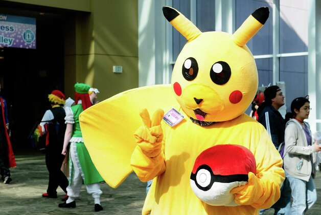 An attendee dressed as Pikachu flashes a peace sign. Photo: LINDSEY WASSON / SEATTLEPI.COM