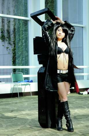 Tawny Fajardo, dressed as Black Rock Shooter, poses for photos. Photo: LINDSEY WASSON / SEATTLEPI.COM