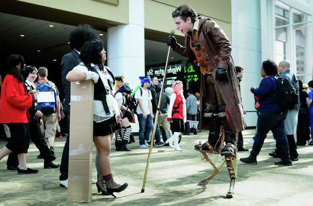 Tobias McCurry, dressed as Generic Steampunk #4, talks with some curious attendees. Photo: LINDSEY WASSON / SEATTLEPI.COM