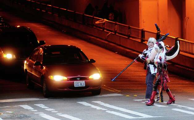 Attendees cross the street in their costumes. Photo: LINDSEY WASSON / SEATTLEPI.COM