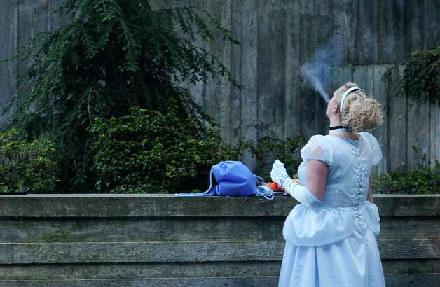 """Cinderella"" takes a break for a smoke outside. Photo: LINDSEY WASSON / SEATTLEPI.COM"