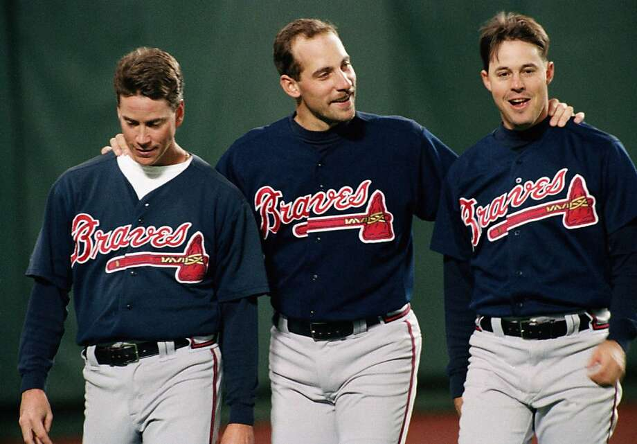 Atlanta Braves pitchers from left, Tom Glavine, John Smoltz and Greg Maddux have a moment together before their game with Philadelphia Phillies at Veterans Stadium, on Oct. 6, 1993.(AP Photo/Doug Mills) Photo: Doug Mills, ASSOCIATED PRESS